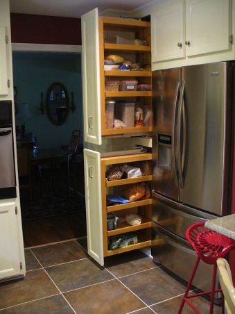 Old Kitchen -> New Kitchen, Reno of 1958 ranch home with laundry room and half bath, These were cavernous cabinets that the former owners stored card tables and chairs (bridge players).  We designed pull out storage inserts. , Kitchens