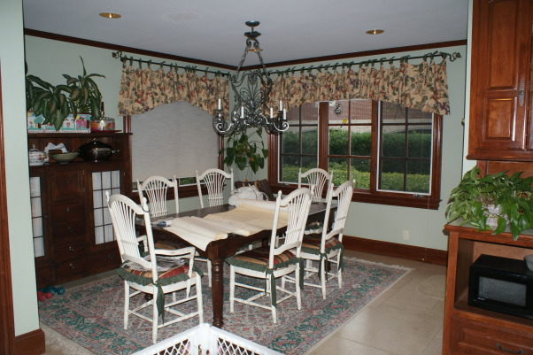 No more dark isolated kitchen, Brighten an existing kitchen and open it up to the flanking unused living space., Before: Breakfast room      , Kitchens