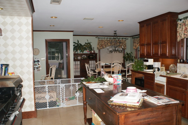 No more dark isolated kitchen, Brighten an existing kitchen and open it up to the flanking unused living space., Before: looking towards breakfast room from kitchen       , Kitchens
