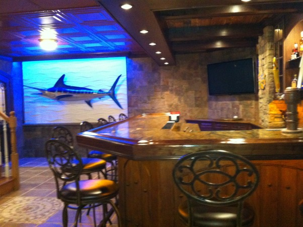 Dude's Den, Basement finished to include wine cellar, smoking room, lounge area, tv area, and pool table area. , The mounted marlin located near the bar outside of the smoking room. Mounted on a swim wall with blue WAC lighting to give it a blue color effect.       , Living Spaces