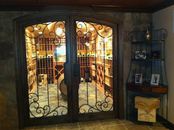 Dude's Den, Basement finished to include wine cellar, smoking room, lounge area, tv area, and pool table area. , Redwood wine cellar. Holds approximately 1600 bottles. Walnut doors with iron scrolls. Slate flooring.       , Living Spaces