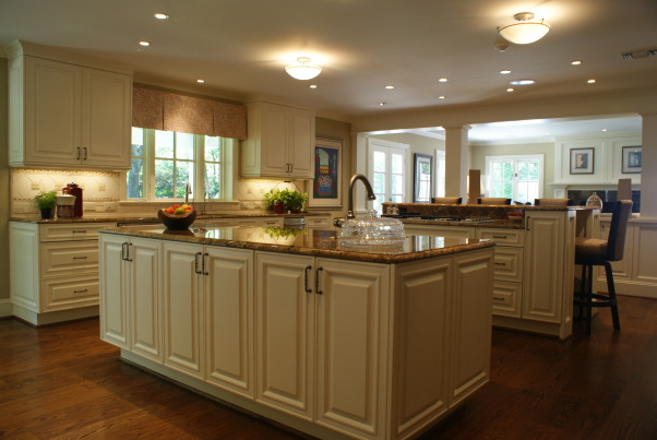 No more dark isolated kitchen, Brighten an existing kitchen and open it up to the flanking unused living space., Kitchens