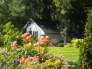 "Toad Hollow, ""Toad Hollow"" small cottage in the corner of our property as viewed through my flower garden. , Gardens Design"