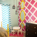 "London's Big Girl Room, Decorating Style: I am in love with big, bold prints and colors...lots of mixtures of textures (ruffles, furriness, and crystal are some faves) and I like a bit of glam.  I also love DIY and budget friendly rooms that inspire and are very doable for a normal, everyday family.  Nothing that costs thousands and is out of reach! Project Details: twin bed:  antique find ($100), made in the 1930s and found on Craigslist.  Painted and laquered by my husband, yellow paint by Olympic.  We also cut about 5 inches of the legs off the bed to make it shorter...it was waaay tall!   table/chairs:  separate antique finds (totaling about $50) and painted/laquered by my husband and me with white primer.  The table is an oak end table!  I liked the ""mix and match"" look of the chairs...they are all different (there is a small stool in the back in addition to the two chairs) and I wanted them all painted the same.   hot pink accent wall:  we painted it white, I taped off the diamonds (didn't measure...just did it) using 3-inch painters tape (widest we could find) and then we painted it hot pink (Olympic) and took the tape off.   black dresser:  was her changing table...took the top part off, added black and white wrapping paper by spray-adhesiving it on and then covered that with Mod Podge.  Replaced hardware with crystal ""glam"" knobs ($2.50 each) from Hobby Lobby.   black/white damask pillow:  already had   black/white dots pillow: Target   teal/white rosette pillow:  Hobby Lobby sale   hot pink bird/branches pillow:  joom etsy shop   hot pink w/small white dots bedding:  Target ($15)   Ruffle duvet cover:  one of the things I actually bought from a store for full price...Urban Outfitters ($140)  I ususally choose 2 or 3 things to purchase in-store and ""splurge"" on...and by splurge I mean a couple hundred bucks total.   White and mirrored Side table:  my second full-price splurge...from Target ($79)   chevron stripe window fabric:  moderncloth etsy shop, sewn by my mother :)   white furry rug:  already had, from Target (was a part of her nursery as well)   Chandelier:  already had, from walmart.com (was a part of her nursery as well) ...was very cheap though!   side-table lamp: already had, used an old lamp shade and recovered it with about $3 worth of pink damask fabric from Hobby Lobby   floor lamp by dresser:  already had as part of her nursery, from Target   Yellow elephant bank:  already had from nursery, from Target   ""faux"" chandelier over table/chairs:  three separate bird cages found at yard sale and Hobby Lobby...I sprayed each of them with black spray paint, hung them at different heights with black skinny ribbon, and tied hot-pink polka dot ribbon to the tops.  Really cheap and I wanted a chandelier look without wiring in a light. Total was about ($35)   3 stacked floor-to-ceiling mirrors:  Bought one from Target for ($19.99) (its the one on the bottom) and already had the other two from my grandma.  Taped them off and sprayed them bright yellow (Krylon yellow spray paint form Hobby Lobby)  I wanted a really really bold look in that corner, from floor to ceiling, without it being too overwhelming with the pink wall and wanted to keep it fairly simple to balance out the huge gallery wall on the other side.  Didn't want tthe pink wall to have anything else on it so it wouldn't be too busy!   pink shag rug under table/chairs:  Hobby Lobby sale ($10?)     Ok, NOW for that HUGE gallery wall!   ""You are my sunshine,"" ""Chin Up Buttercup,"" ""Good Morning Beautiful!"" and  ""I am fearfully and wonderfully made"" GRAPHIC prints were made by ME and can be found in my etsy shop:  West Eighty Third.  Also the paper silhouette in the round frame was made by me and can be found in the shop as well.  The ""L"" flowered letter can be found there too, also made by me.   http://www.etsy.com/shop/westeightythird  frames are a mix of:  Organic Bloom, Modern Knot, and hand-painted Salvation Army/yard sale finds.  Yellow circle frame was a mirror I busted out and painted...black octagon frame was a $.99 black from Salvation Army and I just painted it and put scrapbook paper on the face of it...and inside it is a sheep from London's baby mobile that hung over her bed...we wanted to have as much of her ""nursery"" in the room as possible :)   I painted A LOT of things yellow in this room!  Whew!   ""love"" mirrored letters were $7.50 and from Hobby Lobby.   Almost all the things on this wall were made by me...it was a labor of love!  It took me MONTHS to collect all the things for this wall.  If I didn't actually make it graphically or with paper, I painted it or altered almost everything.   ""So many of my smiles begin with you"" canvas was painted and then the letters were just cut out with a cricut and adhered to the canvas.   I also made the little twine heart.   I am a photographer and also took all the black and white photos displayed. I wanted to have lots of fun photos of London and the people she is closest with as part of the wall!, Girls' Rooms Design"