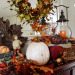 Creating a Fall Mantel that is a little Rustic but still Elegant, I've created this display on my mantel to show that it is possible to mix items that are considered rustic like pinecones and a antiqued pumpkin with glittery leaves and a glass mosaic pumpkin.  Using the burnt oranges, golden yellows, and rusty reds of fall, a display can look cohesive if done correctly.  Everyday objects like vintage baskets and metal lanterns turn into fall decorations when combined with some leaves and berries.  One of the secrets to this look is using different textures and putting the decorations on different levels.  Even the mirror has been used to showoff a beautiful wreath.  I love that all the things that I love can be combined into one display and look complete!, Side view of rustic and elegant fall mantel display, Holidays Design