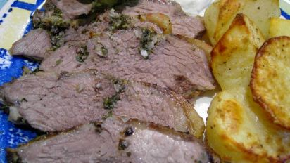 GRILLED BUTTERFLIED LEG OF LAMB WITH LEMON HERBS AND GARLIC