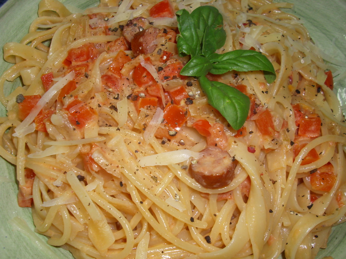 Penne With Sausage, Tomato, Red Pepper in Cream Sauce image