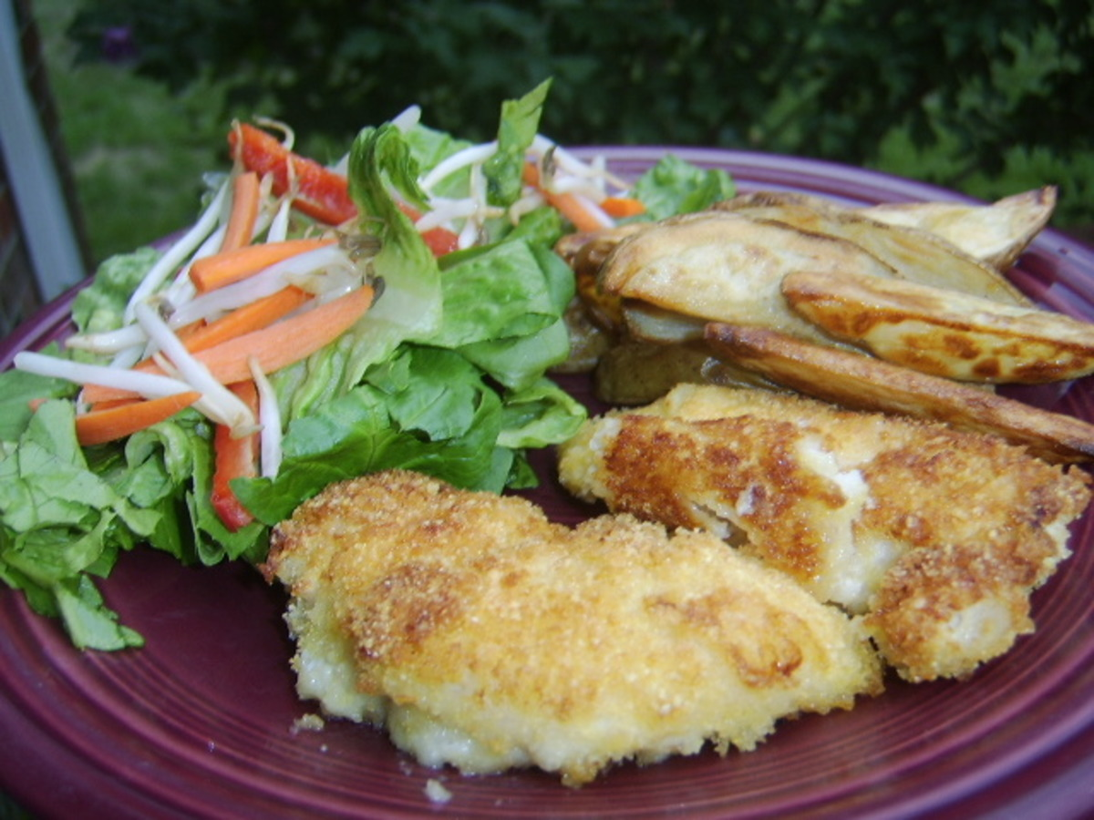Crumbed Chicken With Potato Wedges image