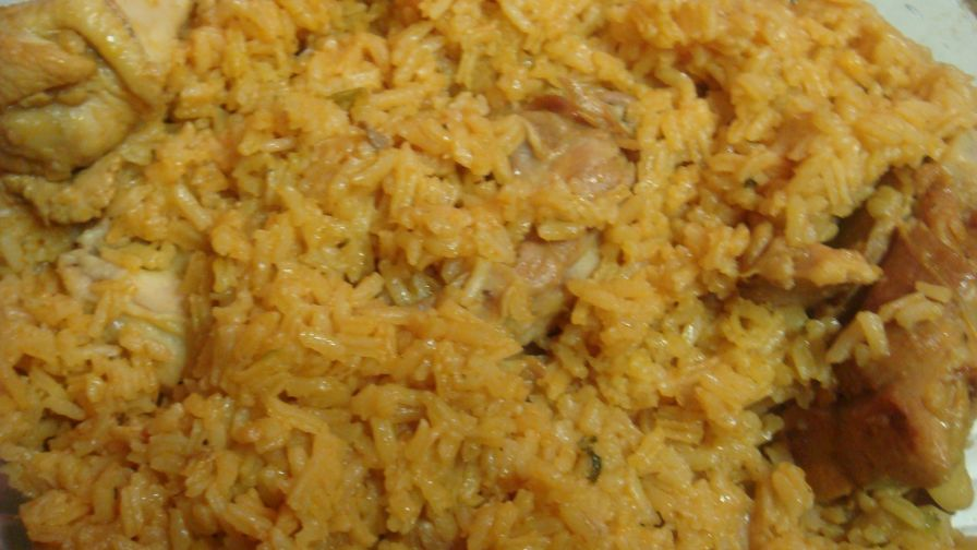 Dominican locrio de pollo rice and chicken recipe genius kitchen 1 view more photos save recipe forumfinder Choice Image
