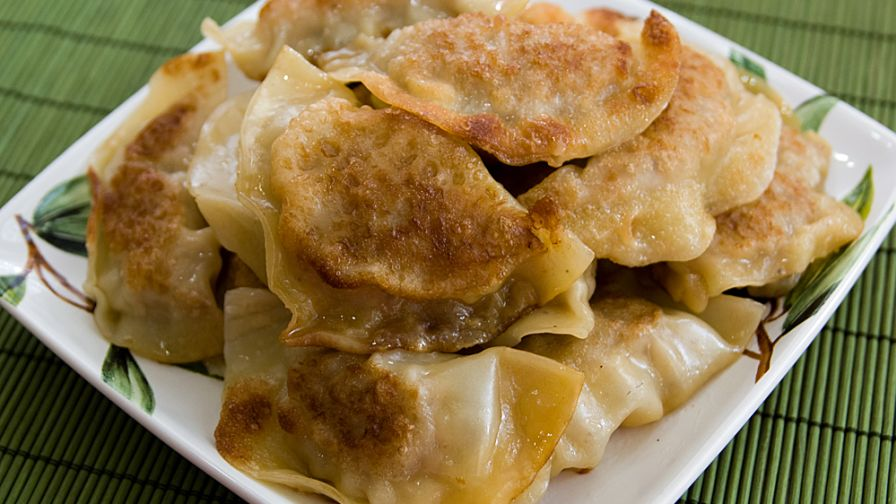 Pot stickers chinese dumplings recipe genius kitchen 12 view more photos forumfinder Gallery
